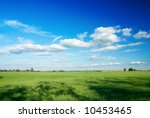 Large piece of land and blue cloudy sky (can be used how background or wallpaper) - stock photo