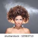 woman hairspray, portrait studio - stock photo