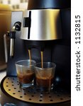 Espresso coffee in the making. - stock photo