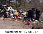 Old tires and rubbish near the road - stock photo