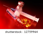 Syringe with medicine bottles and pills with dramatic light - stock photo