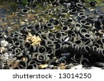 Thousand of tires at the quarry bottom - stock photo