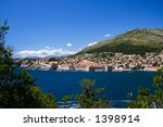 The walled city of Dubrovnik as viewed from the island of Lokrum - stock photo