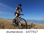 woman mountain biking - stock photo