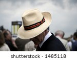 Punter with a panama hat at horse race - stock photo