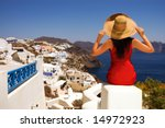 Beautiful young Greek woman on the streets of Oia, Santorini, Greece. - stock photo