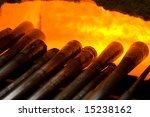 Glassblowing pipes in a furnace - stock photo