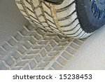Tire Tread and Imprint on Sand - stock photo