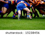 Rugby Scrum.  Two opposing rugby teams pack down a scrum as the ball is put in. - stock photo