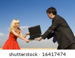 businessman and lady in red fighting for notebook - stock photo