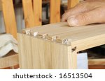 Assembling a dovetail joint. - stock photo