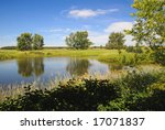 Farm pond in rural Alberta - stock photo