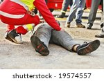 Dead man on the ground and paramedic - stock photo