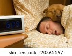 Man and his dog comfortably sleeping in - stock photo