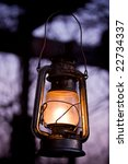Old fashioned lantern in darkness. Light concept. - stock photo