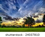 amazing sunset on a golf-course (HDR) - stock photo