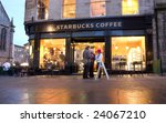 EDINBURGH - JANUARY 28: Starbucks announced it will cut around 6,700 jobs and shut 300 stores on January 28th, 2009. This Starbucks coffee shop is in Edinburgh, Scotland. - stock photo