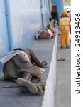 One of thousand's of beggars sleeping on the streets of India - stock photo