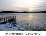 Frozen Winter Dock and Ocean at Sunset - stock photo