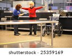 SEATTLE, WA-FEBRUARY 05: A passenger is scanned by a TSA agent at Seattle-Tacoma International Airport on February 05, 2009. The airport serves over 30 million passengers yearly. - stock photo