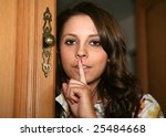A pretty girl asks for quiet - stock photo