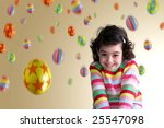 Pretty little girl shrugging shoulders under a colorful Easter eggs rain - stock photo