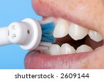 Cleaning the teeth - stock photo