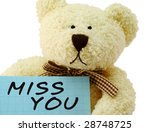 "Front view of teddy bear toy with ""Miss you"" note, isolated on white background - stock photo"
