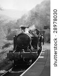 vintage steam train photographed in black and white - stock photo