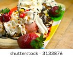 Enormous sundae with fresh fruit - stock photo