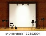 Movie set inside a sound stage with movie lights, movie camera, boom mic, director's chair, megaphone and clapper board - stock photo