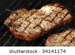 Steak on the grill - stock photo