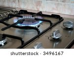 A kitchen hob with the gas turned on. - stock photo