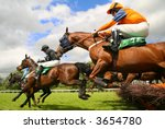 jumping horses - stock photo