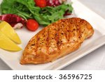 Grilled chicken breast with fresh salad - stock photo
