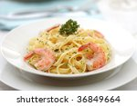 Pasta primavera with grilled shrimps - stock photo