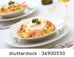 Pasta Alfredo with shrimps - stock photo