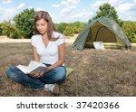 woman tent camping book - stock photo