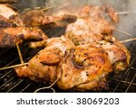 Grill-roasted chickens - stock photo