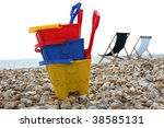 A Child's buckets and spades on the pebble beach at Bognor Regis Sussex - stock photo