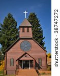 Old log Catholic Church in the town of McCloud, California - stock photo