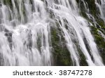 Closeup fragment of a powerful waterfall. - stock photo