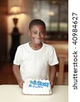 african american child holding birthday cake with white background - stock photo