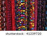 Vibrant ethnic necklaces from seeds on the market - stock photo