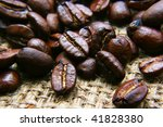 cocoa beans on bagging - stock photo