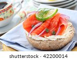 delicious deli lunch, wholegrain bagel with smoked salmon, narrow focus - stock photo