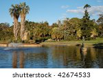Sydney Royal Botanic Gardens - view on a lake with a fountain - stock photo