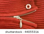 Knitted jacket snake mouth with metal zipper teeth and rivet red eye - stock photo