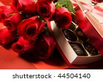 Valentine's day roses, candies and wine on black tray - stock photo
