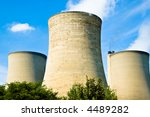 Three power station cooling towers and chimney - stock photo